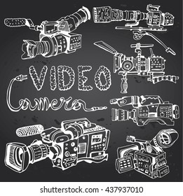 Professional video, digital  camera set with text in movie style. Hand-drawn on a chalkboard.