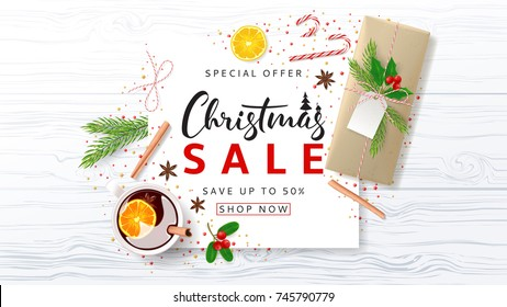 Promo Christmas Banner for Seasonal Sale. Festive Composition with Paper Gift Box and Xmas Symbols for Happy New Year on Wooden Texture. Greeting Card. Vector Illustration with Discount Offer.
