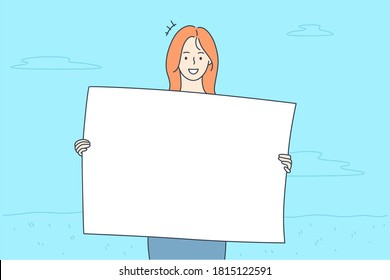 Promotion, business, advertising, protest concept. Young happy smiling businesswoman clerk manager girl cartoon character protestor holding banner in hands looking at camera. Corporate promo ads.