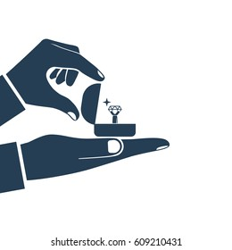 Proposal marriage silhouette, vector illustration minimal flat design. Man is holding in hand an open box with a wedding ring and diamond. Pictogram isolated black icon on white background.