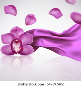 purple orchid flower on a background fabric folds
