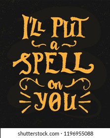I'll put a spell on you phrase, hand drawn lettering, yellow letters on the black charcoal desk texture. Modern vector calligraphy art for banner, poster, greeting card, Halloween party invitation.