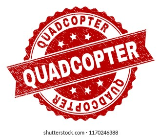 QUADCOPTER seal print with corroded texture. Rubber seal imitation has circle medal shape and contains ribbon. Red vector rubber print of QUADCOPTER text with grunge texture.