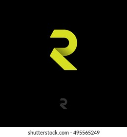 R logo. R monogram. Yellow origami letter on dark background.