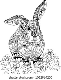 Rabbit among the flowers. Freehand sketch drawing for adult antistress coloring book