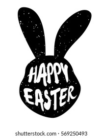 Rabbit head silhouette with inscription Happy Easter. Vector.