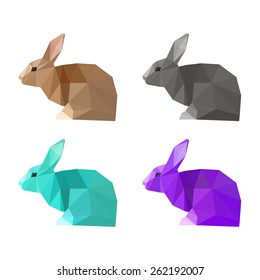 Rabbit painted in imaginary colors. Abstract polygonal rabbit for card, invitation, book, placard. Triangle geometric low poly rabbit set isolated on white. Wildlife, forest animals, nature theme.