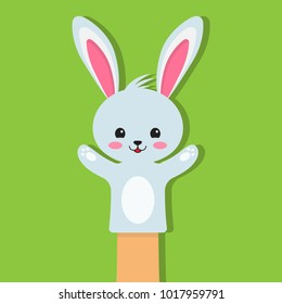 Rabbit puppet on a green background. Puppet toy in theater, Vector illustration
