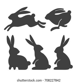 Rabbit set. Stylized silhouettes of sitting and running rabbits, isolated on white background. Vector illustration.