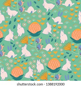 Rabbits and colorful flowers in a seamless pattern design, that cand be used in print, for different type of fabric, or for web