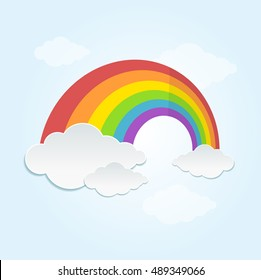 Rainbow and Cloud in The Sky. Cartoon Flat Design Style. Vector illustration of color rainbow's lines and clouds.