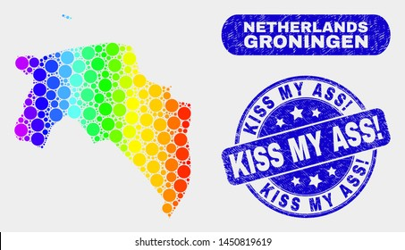 Rainbow colored dotted Groningen Province map and stamps. Blue round Kiss My Ass! grunge seal stamp. Gradient rainbow colored Groningen Province map mosaic of randomized round dots.