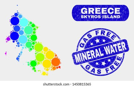Rainbow colored dotted Skyros Island map and seal stamps. Blue rounded Gas Free Mineral Water textured stamp. Gradient rainbow colored Skyros Island map mosaic of scattered small spheres.