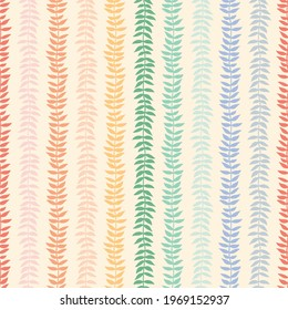 Rainbow colored leaf vines striped seamless vector pattern on an ivory background. A simple and colorful pattern perfect for fabric, wallpaper, stationery, gift wrap, packaging or scrapbooking.