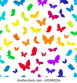 Rainbow colorful silhouettes of butterflies on a white background seamless pattern.