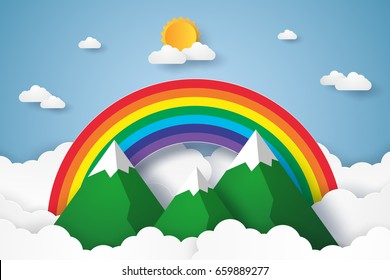 Rainbow and mountains on blue sky with cloud , paper art style
