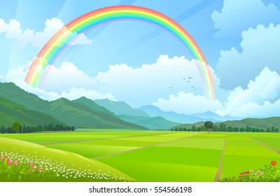 Rainbow over the mountains, hills and rice fields