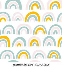Rainbow seamless pattern in pastel colors. Scandinavian vector baby hand drawn illustration perfect for textiles and newborn clothes.