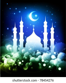 Ramadan background - mosque silhouette and crescent moon at night - blue and green colors