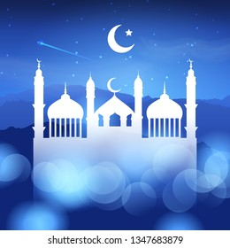 Ramadan background with silhouette of mosques against a night sky