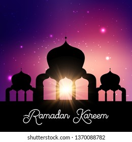 Ramadan Kareem background with mosque silhouette against a night sky