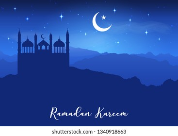 Ramadan Kareem background with mosque silhouettes against a night sky