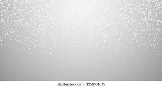Random white dots Christmas background. Subtle flying snow flakes and stars on light grey background. Beauteous winter silver snowflake overlay template. Pleasant vector illustration.