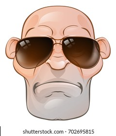 A rather mean looking tough skinhead thug or hard man wearing sunglasses