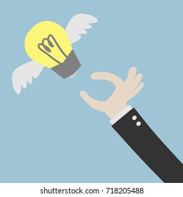 Reaching The Flying Idea. Catching The Flying Idea. Buisness man hand, light bulb with wings at green backgound in flat design. Concept for web design, infographic. Vector Illustration