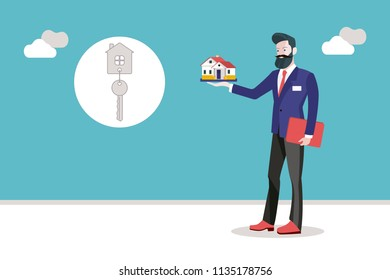 Real estate agent man holding a miniature house in his hand.