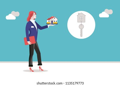 Real estate agent woman holding a miniature house in her hand.