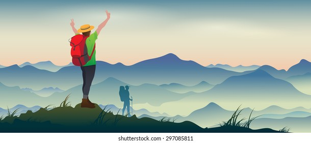 The real picture of happy tourists with backpacks on the background of a mountain landscape.