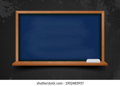 Realistic blank black chalkboard in wooden frame