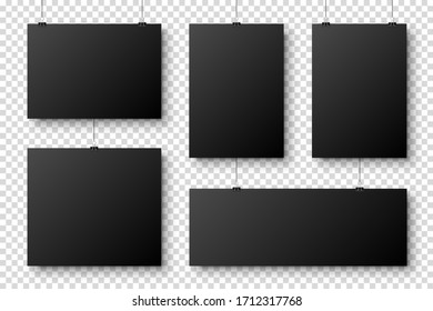 Realistic blank paper sheets hanging on binder clip. Black poster with shadow in A4 format. Design template, mockup. Vector illustration.