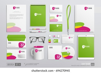 Realistic Corporate Brand Identity Mockup set. Green and pink corporate graphics on annual report cover, notepad, envelope, blank, business card, mug, usb. Business Office stationery mockup template