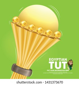 Realistic cup award for African Nations Cup 2019 and soccer player Cartoon TUT with head Tutankhamun sport design on green background