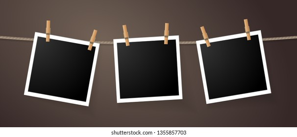 Realistic detailed photo icon design template. Photo frames hanging on the rope with clothespines