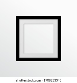 Realistic empty frame on the gray wall. Black square photo frame empty blank mockup. Vector illustration eps10.