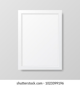 Realistic empty white picture frame, isolated on a neutral gray background.