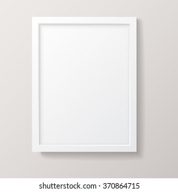 Realistic Empty White Picture Frame - Realistic empty white picture frame, isolated on a neutral gray background. EPS10 file with transparency.