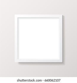 Realistic Empty White Square Picture Frame Mockup - Realistic empty white square picture frame with mat, isolated on a neutral off-white background. EPS10 file with transparency.