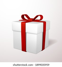 Realistic gift box with red bow isolated on gray background. Vector illustration.