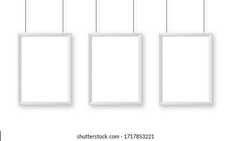 Realistic hanging on a wall white blank picture frame. Modern poster mockup. Empty photo frame. Vector illustration.