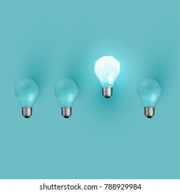 Realistic light bulbs on turquoise background, vector illustration