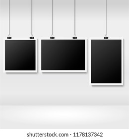 Realistic photo frames hanging on binder. Vector