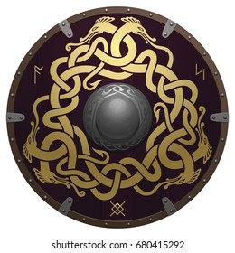 Realistic round shield of the Viking. Medieval wooden armor with iron details. Shield is decorated by runes and original golden ornament in a form of interwoven dragons on a dark reddish-brown field.
