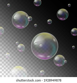 Realistic soap bubbles with rainbow reflection set isolated on a transparent background.