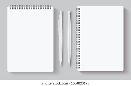 Realistic spiral notebooks. Blank notepad and white pen. Vector illustration mock up empty template books for corporate identity isolated on gray background for business presentation