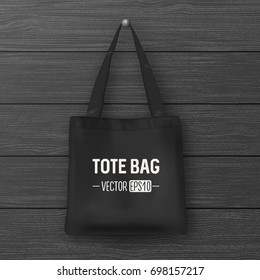 Realistic vector black empty textile tote bag. Closeup on wood background. Design template for branding, mockup. EPS10.