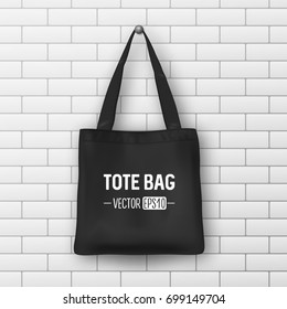Realistic vector black textile tote bag. Closeup on brick wall background. Design template for branding, mockup. EPS10.